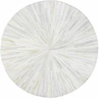 Roll out the chic style in any room in your home with this chic rug. Brimming with contemporary style and unexpected elegance, this accent is sure to make a statement in any space. The hand-stitched leather design and striped pattern imbue this rug with distinct, chic style, while the neutral color palette makes it perfect for any ensemble. Try rolling it out in your foyer to craft a grand entryway display, then build on the contemporary appeal by adding a clean-lined wood console table topped...