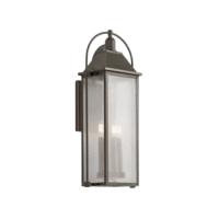This has an updated traditional design inspired by classic carriage lanterns, featuring a clear, seeded glass for a highly textured appearance and brass candle accents for a warm glow.