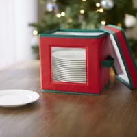 Stash your seasonal serveware in style with this holiday dessert plate or bowl storage chest, perfect for keeping your dishes safe and dust-free. Made from polyester plastic, it can hold up to 12 plates or bowls and features felt dividers to keep your dishes protected and chip-free. A convenient top helps to secure its contents, while a clear window on the front of the box allows you see what's inside with a quick glance. Though this piece is perfect for storing serveware any time of the year...
