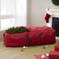 When January rolls around and it's time to take the holiday decorations down, this artificial tree storage bag is a must-have.  Less bulky than the box it came in and much easier to carry with two handles and a rolling base, this product keeps your Christmas tree safely stowed until next season without the risk of dust and moisture. Made from moisture-resistant polyester, it offers a lightweight design with festive hues of red and green. This bag accommodates folded artificial trees or trees up...