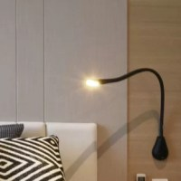 Wall mounted task lighting with an adjustable neck and a natural leather finish. Touch activated switch and USB port charging station.