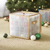 Just because you're not decking the halls doesn't mean your holiday essentials shouldn't be stowed in festive fashion! Keep ornaments safely tucked away in style with this organizer box. Crafted from polypropylene, the frame features a dotted pattern with matching trim and a handy zippered top to keep items in their place. Paper dividers offer space for up to 64 pieces, but they're not a hassle to carry thanks to two built-in handles for easy transport.