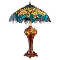 Peacock feathers boast some of nature's most vibrant hues and Design Toscano captured them for your home or office! Drawing upon the style and techniques of the master of stained glass, Lewis Comfort Tiffany, this turn-of-the-century replica Art Nouveau Peacock table lamp casts flattering, softly diffused light. Each individually hand-cut piece of vibrant, authentic art glass shines as part of a stylized peacock feather motif that terminates in a filigree metal fringe with center cabochons....
