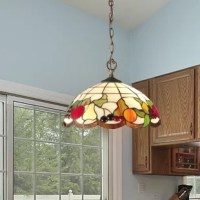 Dale Tiffany lovely Fruits 2 Light Bowl Pendant does double duty as both functional light source and illuminated still life artwork. The generously sized dome shade features a background of light amber glass panels set in a grid pattern. The shade's bottom edge is lovely border of apples, pears, oranges, grapes and cherries each so realistically represented, you will want to eat them. Dale Tiffany have added art glass gems throughout the design for added texture and sparkle and wrapped the...