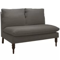 Whether it's a small-space centerpiece or a stylish accent in a larger room, this  Loveseat is the versatile piece you need. Features a simple armless silhouette piled with plush cushions and elegant front legs with turned styling. Hand-finished upholstery in your choice of fabric.