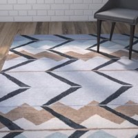 A multicolor geometric motif gives this hand-tufted rug a touch of Southwestern style that elevates any arrangement. Use it to anchor a lodge-chic entryway ensemble or add it to the den to define space.