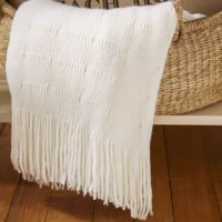 Uniquely blended materials, this throw will add style to any room.
