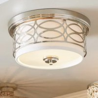 Designed to attach to the ceiling, flush mounts lend a light to small spaces or rooms with lower ceilings, such as entryways and bathrooms. Stylish, too, this luminary exudes chic appeal as well as it diffuses light. Crafted from metal, it showcases a geometric design highlighted by an included drum shade and matching finial. In terms of illumination, two 60 W bulbs (not included) cast their glow throughout your home.