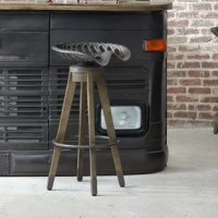 Inspired by the country tractor of days gone by, the Linville Farm Bar Stool is a truly unique addition to your entertaining area. Swivel tractor metal seat and foot rail add comfort and tapered wood legs provide rustic flair. Part of Eric Church's Highway to Home Collection, the Linville Farm Stool is perfect for industrial or loft-inspired design areas.