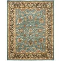 Who says artful allure has to be limited to what's hanging on your walls? Bring a bit of bold beauty to space underfoot in your master suite or living room seating ensemble with this eye-catching area rug, showcasing a Persian-inspired motif in hues of blue and beige. Made in India, it is handmade using 100% pure wool with a low pile height and cotton backing that should be paired with a rug pad.
