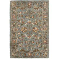 With rich, luscious detailing and a vibrant feel, this area rug brings life to any space. Hand-tufted of pure wool with a strong cotton backing, these traditionally beautiful rugs can withstand even the most highly traveled areas of your home.