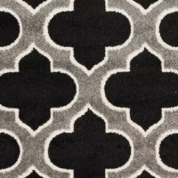 Coordinate indoor and outdoor living spaces with this Maritza Black/Gray Indoor/Outdoor Area Rug. Power-loomed of long-wearing polypropylene, beautiful cut pile rugs stand up to tough outdoor conditions with the aesthetics of indoor rugs. Use these family-friendly geometric designs on patios, in kitchens, busy family rooms and other high traffic rooms.