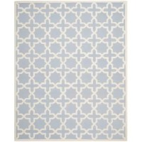 Tasteful and transitional, this understated area rug showcases a raised geometric pattern in light blue and ivory hues for a subdued splash of color. Hand-tufted in India from 100% wool with a medium 0.63