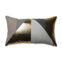 Give your rooms a show-stopping style with this geometric pillow with shimmering triangles made from luxe metallic gold, charcoal gray, and neutral taupe. These interlocking shapes draw the eye while the rustically textured base cloth adds unique slubs to the fabric that show through every color of the design. This plush throw pillow will make a perfect accent to gold- or even Christmas- decor where it will pick up the light in your room to shimmer all night. It features a zipper and Duck...