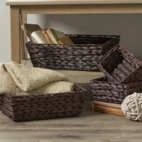 Keep clutter under control with this four-piece wicker basket set! Founded on a metal wire frame, each basket strikes a rectangular silhouette wrapped in handwoven bamboo wicker in a burnished brown finish. Including one large (5'' H x 16.5'' W x 12.5'' D), one medium (4.5'' H x 14'' W x 11'' D), and two small baskets (3.5'' H x 8.5'' W x 6.25'' D), this set can be nested when not in use for space-saving storage.
