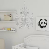 Brighten up your little one's restful retreat or playroom ensemble with this stylish chandelier. The perfect pick for a variety of design aesthetics from traditional to glam, it showcases a curved metal frame and dangling crystal accents an eye-catching look. Four candelabra-style lights direct light upward for an ambient look, and each accommodates one 25 W E12 lightbulb (not included). Plus, it's compatible with a dimmer switch for adjustable ambiance and can be installed on a sloped...
