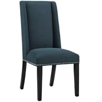 Dress up your dining room for an upcoming dinner party or round out a breakfast nook ensemble with this stylish side chair. Founded atop four legs finished in black, its frame is crafted from solid rubberwood. Foam padding lends comfort to the seat, while polyester upholstery in a solid hue wraps around to tie it all together. Plus, there's nailhead trim lining the base for a pop of polish.