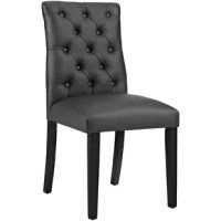Striking an updated parsons silhouette, this dapper dining chair features an armless L-shaped seat.  Deep button tufting lends a tailored touch, while 3
