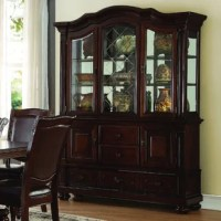 Display cherished collectibles on a stage that's equally adored with this traditional china cabinet. Crafted from manufactured wood in a warm dark brown finish, this generously sized piece measures 83.75'' H x 60.25'' W x 19.5'' D overall to offer ample storage space. Clear glass sides and lockable doors up above make it easy to see the trinkets you've tucked within, while two additional cabinets and five drawers below provide concealed storage for any odds and ends strewn about your abode....