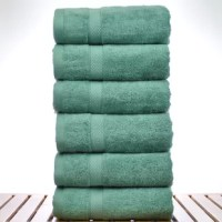 Wrap yourself up in the cozy comfort of Luxury Hotel and Spa 6 Piece Turkish Cotton Hand Towel. Crafted from a blend of rayon from bamboo and Turkish Cotton in pebbled texture. These towels are silky smooth and extra absorbent with snag resistance and also have natural antimicrobial qualities making them hygienically ideal for daily use. Because of these properties they resist mold and mildew even in humid environments. Rayon from Bamboo fiber is an eco-friendly resource too. Bamboo is also a...