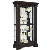 The Glencoe Curio is a stately addition to your home to display your most prized possessions. It features Asian hardwood solids with Acacia veneers and is finished is a deep, cherry finish that adds a rich drama to a dining room, hallway or den. Four adjustable shelves, one stationary or removable shelf, a mirrored back and two dim-able LED lights create a pristine display. Intricate moldings make this curio as beautiful as what's displayed within.