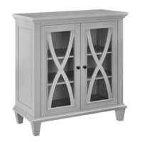 A place to corral miscellaneous items, a spot to stage decorative displays, and a way to craft a cohesive look in any room of your home, accent cabinets are must-have additions to any decor. Standing atop tapered legs, this design is crafted from manufactured wood and features a streamlined silhouette emblematic of the traditional aesthetic. A pair of doors fronted by x-shaped cutouts and glass panels open to reveal three shelves upon which you can tuck away a variety of objects.