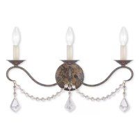 An antique-inspired design gets a glamorous update with this three-light wall sconce. Crafted from stainless steel, this fixture features a round backplate and three curling arms with boboches up top in a Venetian golden bronze finish, giving it a well-worn look. A trio of 60 W candelabra-base incandescent bulbs is left exposed to cast a warm glow over your space, while clear crystal beads cascade below for a bit of bling. The manufacturer backs this product with a one-year warranty.
