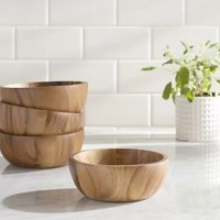 Making your space your own is one of the best parts about moving in, or when you're simply trying to changing up what you already have. Incorporate objects that speak to you, like this bowl set for example: Crafted from acacia wood, it features a natural aesthetic awash in a brown hue, allowing it to blend with a variety of color schemes.