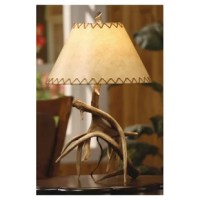 Borrowing decorating tips from Mother Nature herself, this woodland-chic lamp evokes sylvan style for your home. Showcasing a charming woodland design and faux leather shade, this antler-inspired table lamp brims with natural appeal for your living room or den.  Create an elegant-yet-exotic escape with this cabin-inspired design. Fill your home with elaborately patterned headboards and luxe poufs, then embellish the look with crystal wall sconces, starburst mirrors, and more. Indulge in boho...