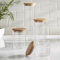 4 Piece Storage Jar Set, adds a stylish element to your kitchen with this sleek look. Each jar includes an air-tight, bamboo lid. Canisters are made of durable borosilicate glass.