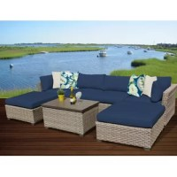 This outdoor furniture is perfect for when you want to sit back with a glass of wine and catch up with friends – or just catch up on some reading. This 7-piece patio seating set is crafted from rust-resistant aluminum wrapped in resin wicker, so you don't have to worry about bringing it inside when the weather takes a turn. A sectional sofa, two ottomans, and a storage coffee table feature modern silhouettes for a fresh take on wicker furniture. The whole conversation set comes fully...