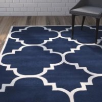 The collection by ancient Moroccan motifs with a fashion-forward palette of bright and pastel colors. These stunning hand-tufted wool rugs are crafted in India to recreate the elegant look of hand-knotted carpets for today.