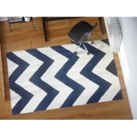Give your home decor a fresh look with the Teresita Hand-Tufted Wool Dark Blue/Ivory Area Rug. The beautiful chevron pattern in ivory and dark gray is what makes this rug a charming addition to a contemporary home. This rug is very soft to touch and will give a pleasant sensation when you walk on it. This Teresita Hand-Tufted Wool Dark Blue/Ivory Area Rug is a wide range of sizes, letting you choose the one that best suits the requirements of your home.