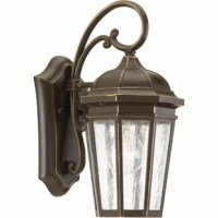 This wall lantern offers traditional styling for a variety of exteriors. It features a classic and formal clear seeded glass and an open bottom design which allows for easy access to replace lamps without removing any pieces.