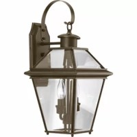 Originally made to encase the light of a flickering flame, lanterns were first designed for function, not fashion. Today, they incorporate both. Take this one for example: Crafted from metal, it showcases a tapered silhouette with a curled arm, lending instant traditional appeal to your aesthetic. Beveled glass panels diffuse light from any two candelabra-base bulbs up to 60 W (not included), while a wet location rating makes it ideal for an enclosed patio ensemble.