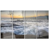 Bring contemporary abstraction to your home with this metal wall art. This 'Troubled Sunset Sea Waves' 4 Piece Photographic Print on Canvas Set makes it the focal point of any room or office.