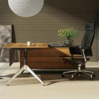 Elevate the office in style with the help of this executive desk. Crafted from manufactured wood and metal, this Executive Desk showcases an L-shaped design that's perfect for any corner or spacious office. It arrives with two drawers on ball-bearing glides and two cabinets, so there's plenty of space to tuck away loose odds and ends. A neutral finish allows this desk to blend with a variety of color schemes, and as a bonus, it's backed by a five-year warranty.