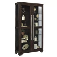 This handsome collector's Quakertown Lighted Curio Cabinet is designed with honest simplicity. The oak veneers have been distressed just enough to enhance the character of the wood, then finished in dark brown. Two front opening doors give easy access to the interior. The oversized burnished metal handles give a hint of industrial for an updated look. LED lights in the top of the cabinet enhance the contents. Four of the glass shelves are adjustable and the fifth one has an assigned position...