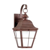 When done right, outdoor lighting adds style, safety, and curb appeal to your exterior ensemble. Bringing the comfort of lodge-inspired decor to your front door, this outdoor lantern features a brass body with a weathered copper finish. Its glass shade and metal body complements your home's architecture with industrial style while increasing security and brightening up your walkway for approaching guests. Plus, it is ENERGY STAR®-qualified for added efficiency. Accommodates one 10 W A19 LED...
