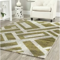 A large scale geometric pattern on the diagonal defines the contemporary Milano accent rug from the Shroyer collection. An easy way to refresh contemporary and transitional living rooms, this bold fashion neutral rug is power-loomed of long wearing polypropylene yarns for easy care.