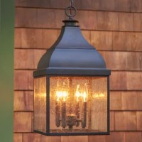 Nothing says rustic elegance quite like the warm glow of a lantern. Take this one for example: evoking remote shore houses and lakeside camps, this 21.5'' H x 6.25'' W x 6.25'' D hanging pendant brings light to breezeways, porches, covered outdoor dining areas, and more. Inside, there's space for a 75 W incandescent bulb, which is not included. Crafted from aluminum and steel with X-shaped wooden accents, it's rated for outdoor use.