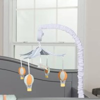 """Encourage eye tracking and sound perception skills with Dr. Seuss Oh, the Places You'll Go! Musical Mobile by Trend Lab. Four plush hot air balloons are suspended from white felt """"clouds"""" to slowly rotate to Brahms' lullaby music. Mobile easily attaches to most cribs."""