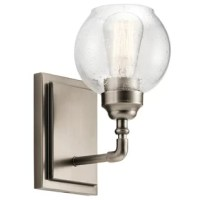 Blending sleek style with a touch of vintage inspiration, this charming armed sconce is a lovely addition to any home. A perfect pick for cottage-chic aesthetics, it showcases a rounded seeded glass shade and a space for one incandescent bulb (which is not included). The light is set on an angled arm with turned details and a rectangular base. The frame is available in two finishes, so you can find the right hue for your home.