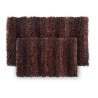 The plush, highly-textured SeaBreeze polyester shaggy rug features shag construction, bringing comfort underfoot while the palette of fashion-forward solid hue commands attention in any room.