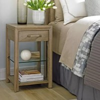 The square night table is scaled for smaller bedrooms and features a storage drawer, an adjustable glass shelf and a stationary wooden shelf at the base.