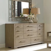 The stately dresser features a drop-front design for access to media components and with eleven drawers, provides ample storage for clothing. Its drawer pulls highlight the grain of the wood and enhances its taupe-gray finish.