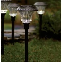 Illuminate your walkway or patio with this timeless path light, featuring solar power on the cap.
