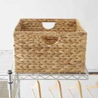 Low on storage space in your kitchen or bedroom? This versatile two-piece basket set gives you an extra place for all your favorite things. Crafted with a metal frame, it's wrapped in hand-woven water hyacinth that showcases a natural beige hue. Each basket strikes a simple square silhouette with built-in U-shaped handles for easy handling. Place them in the foyer or mudroom to store mittens, hats, and work gloves, or set them on a bakers rack in this kitchen as a catchall for odds and ends...