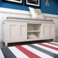 Cut the clutter in your entryway, mudroom, or walk-in closet with this essential storage bench. Showcasing a paneled design, with two interior shelves in the center. It's perfect for sitting down and pulling your favorite pair of shoes on or offering guests a convenient spot to sit down and remove their shoes. Made out of solid and manufactured wood in an eggshell finish, with a polyester and linen blend upholstered cushion in blue and gray color.