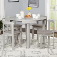 Designed with smaller spaces in mind, this compact five-piece dining set is perfect for cozy eat-in kitchens or first apartments that are short on square footage. Crafted from manufactured wood and rubberwood, this budget-friendly set includes one round table and four low-profile matching chairs (each with a 170 lbs. weight capacity). A neutral finish gives this set the versatility to blend with any color palette you pick, while upholstered, foam-filled seat cushions provide a bit of comfort.
